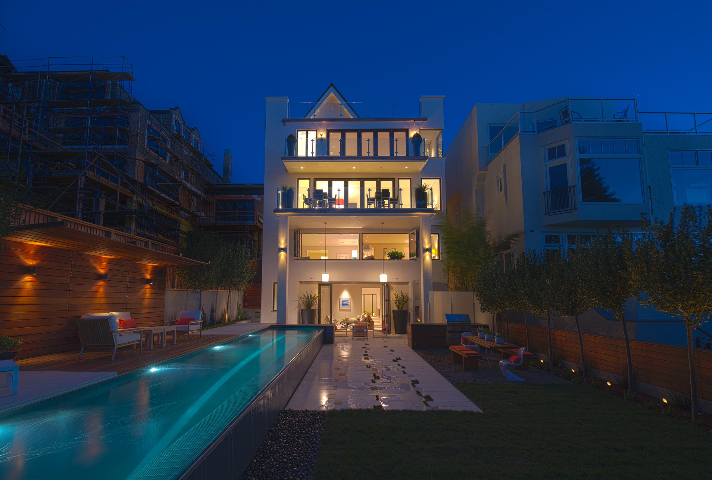 Residence 2750 rear facade and garden at night