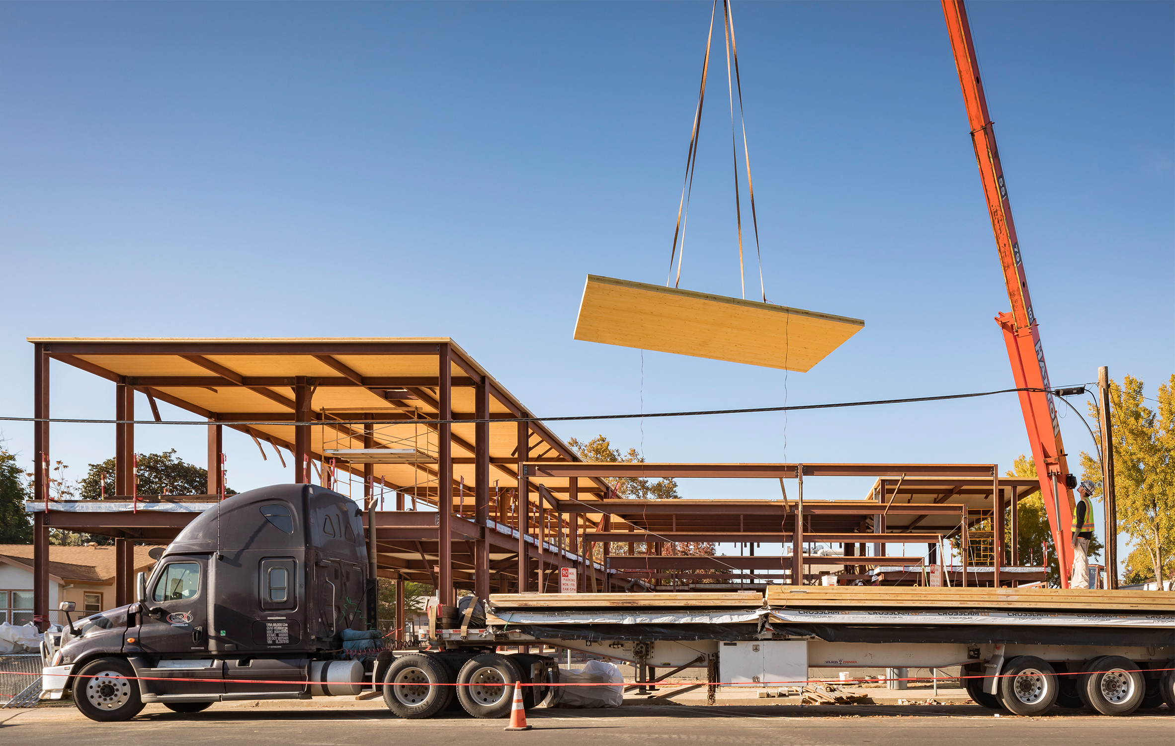 Brentwood Public Library truck unloads CLT panels