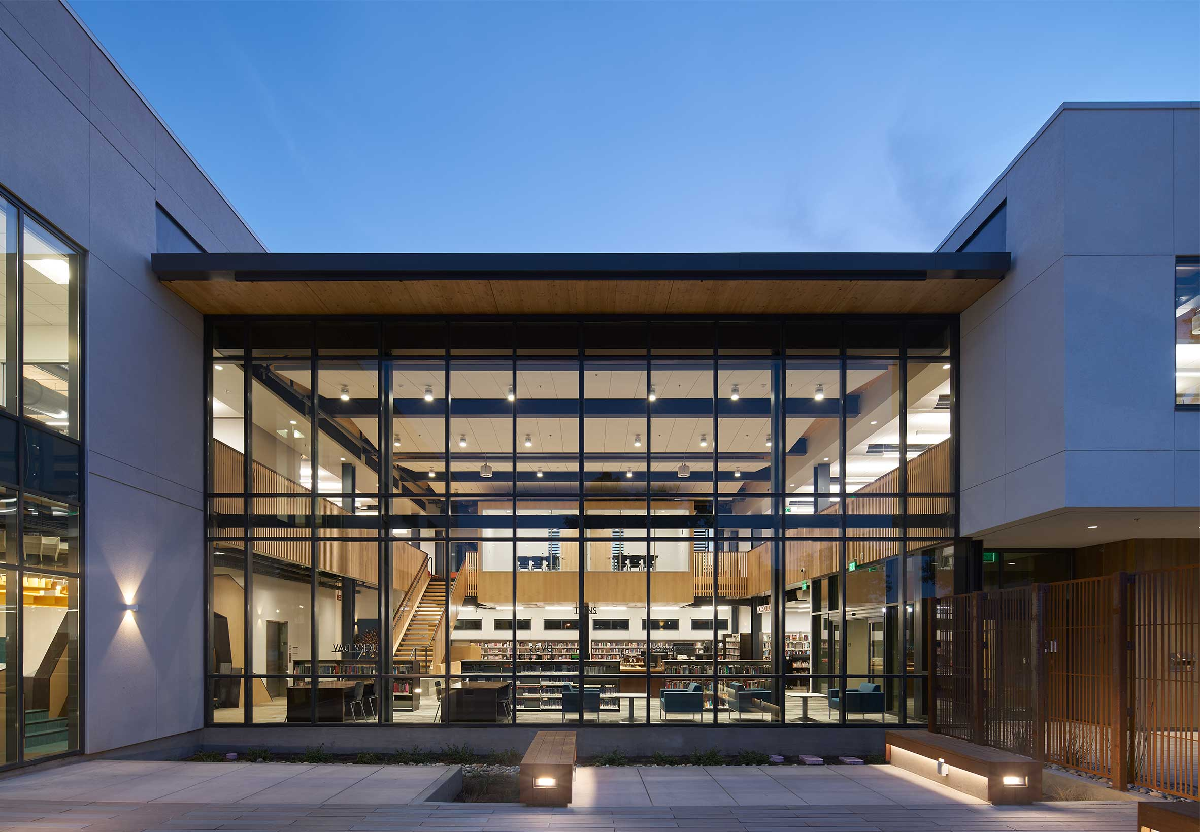 Brentwood Public Library finished exterior with lights on at dusk