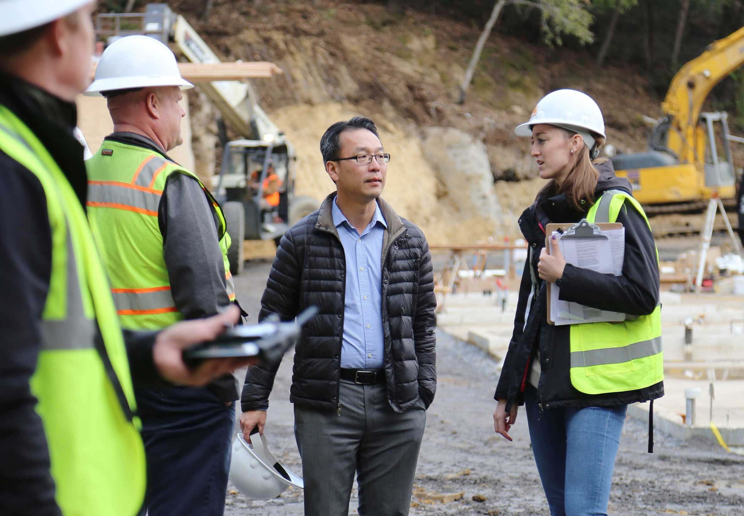 Holmes Structures Residential Studio Lead Principal Denny Kwan Onsite for Custom Home Construction in California