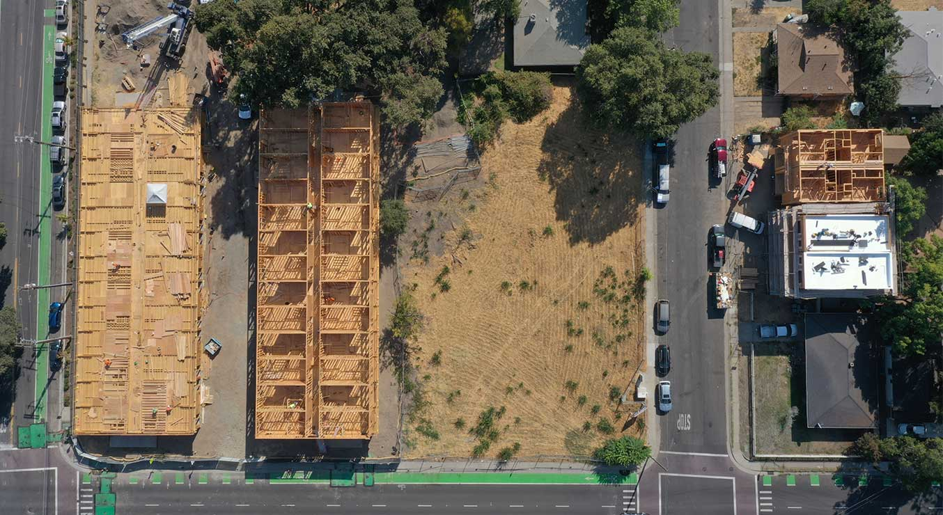 Aerial drone view of mass timber apartments under construction The Kind Project West Sacramento, CA